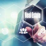 Businessman pressing an Real Estate concept button.