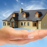house-in-hand-with-blue-background